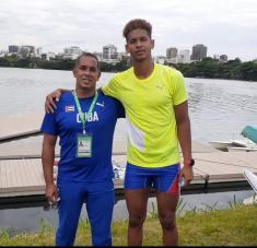 Carlos Andriel junto a su timonel Joan de Paula en el clasificatorio de río de Janeiro. Fotos: Tomadas de Tele Rebelde.