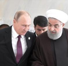 El presidente ruso, Vladimir Putin, (izq.) y su par iraní, Hasan Rohani, en una cumbre en Aktau, Kazajistán, 12 de agosto de 2018. Foto: Reuters.